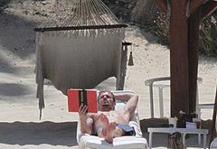 Cam Gigandet sunbathing