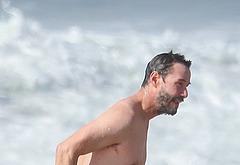 Keanu Reeves shirtless beach photos