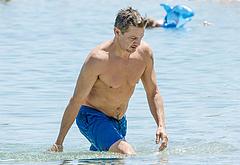 Jeremy Renner naked on a beach