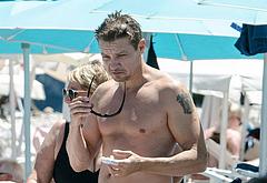 Jeremy Renner shirtless on a beach