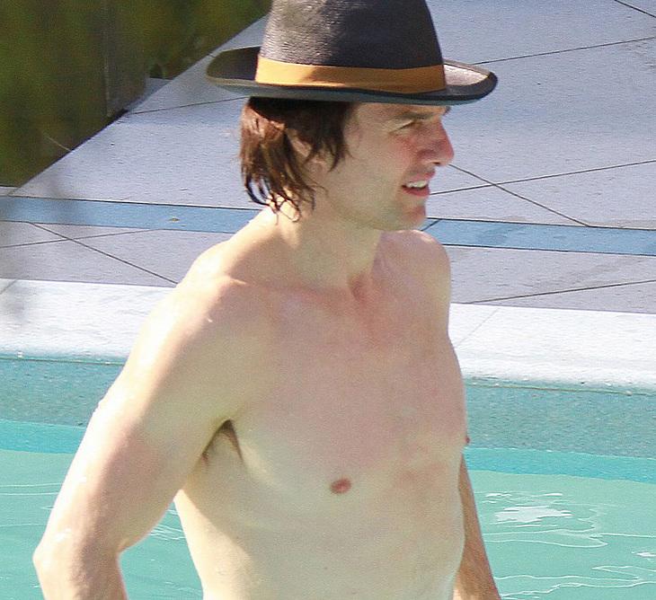 Tom Cruise sunbathing