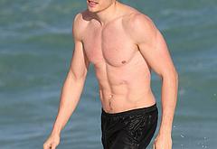Karl Glusman shirtless on beach